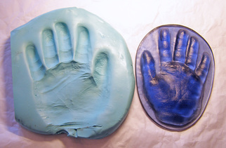 hand print casting taken from impression in putty